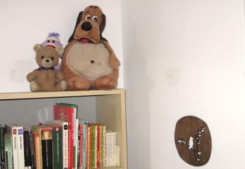 stuffed animals on bookcase